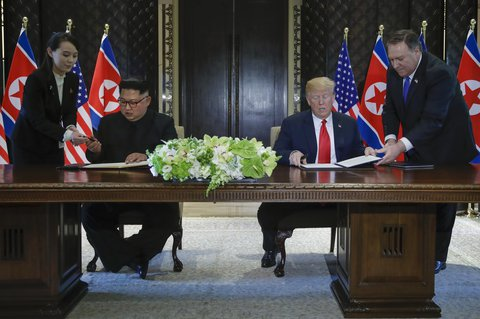 The moment before Trump and Jong Un signed documents together after their meeting in Singapore.